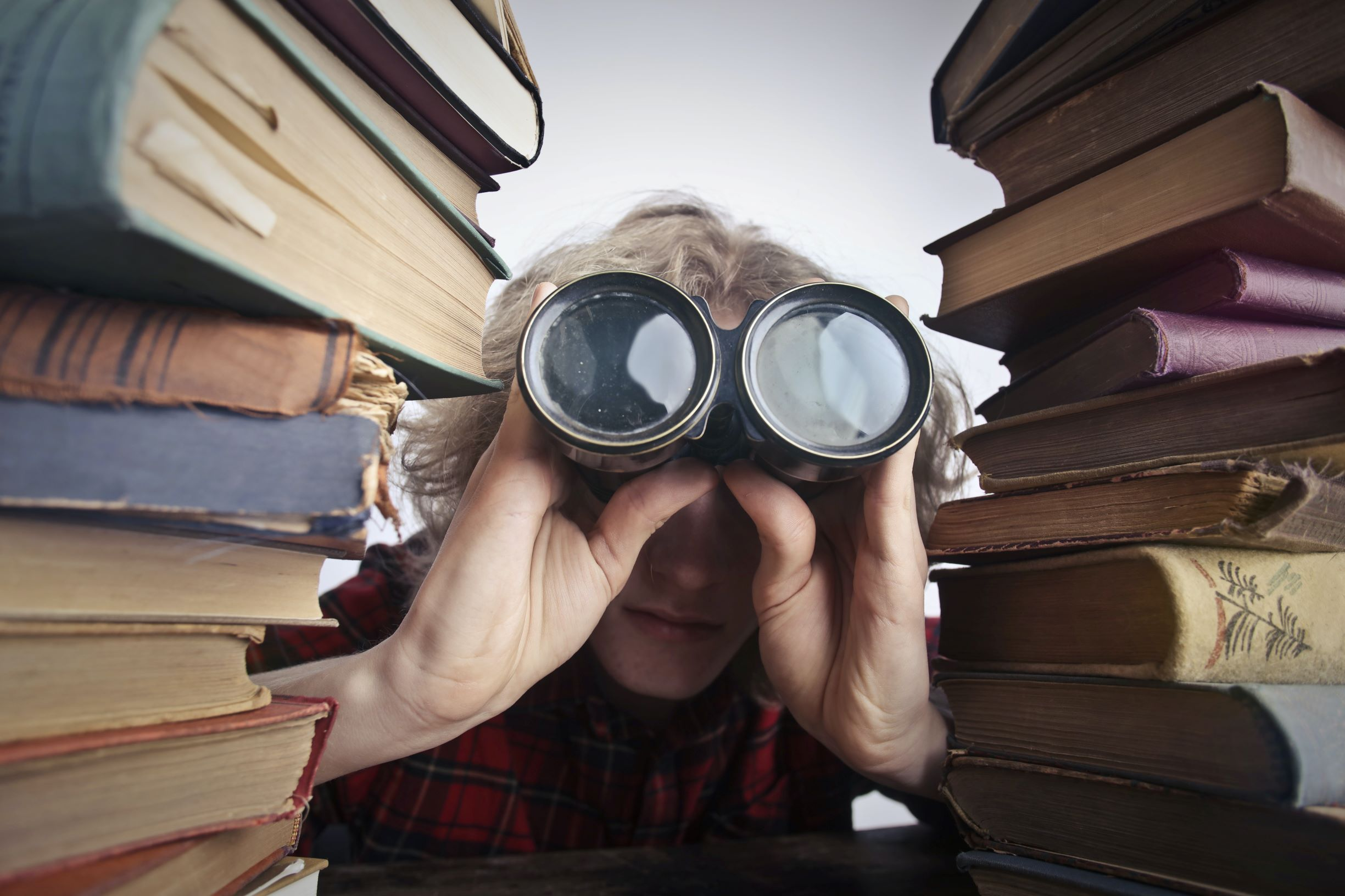 librarian looking for books with binoculars