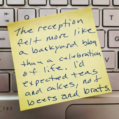 post-it note with reminder to write